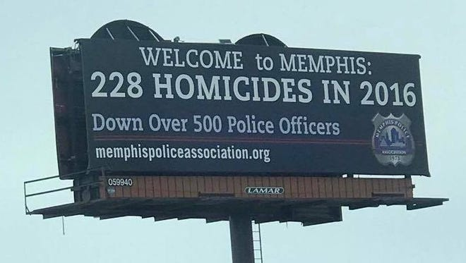 The Memphis Police Association emphasizes the city's murder rate in a billboard pressuring Mayor Jim Strickland to restore benefits to city employees.