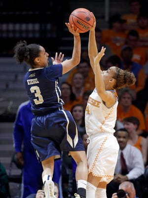 Tennessee guard Andraya Carter (14) tries to block the shot of Pittsburgh guard Brianna Kiesel (3).