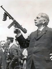 Gen. John T. Thompson of Newport displays his invention, the Tommy gun, which he intended for military use, but it became the favorite weapon of gangsters in the 1930s. Gen. John T. Thompson, inventor of the Thompson submachine gun, or Tommy gun. Scanned from Enquirer files, August 12, 2015 Cropped