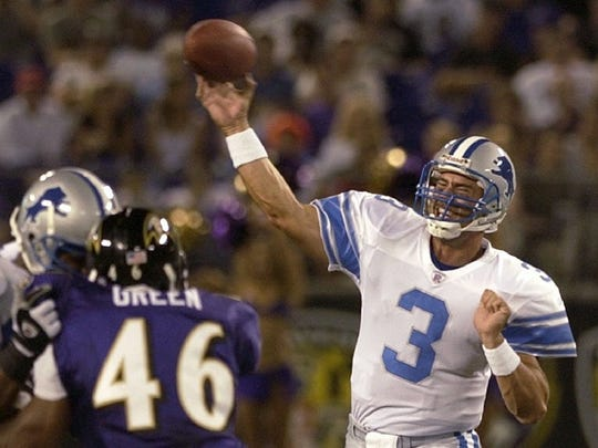 -  -Detroit Lions quarterback Joey Harrington (3) passes as Baltimore Ravens linebacker Louis Green (46) closes in during the third quarter Friday, Aug. 9, 2002, at Ravens Stadium in Baltimore. (AP Photo/Nick Wass)