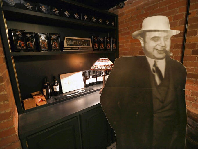 A cutout of notorious gangster Al Capone is shown in