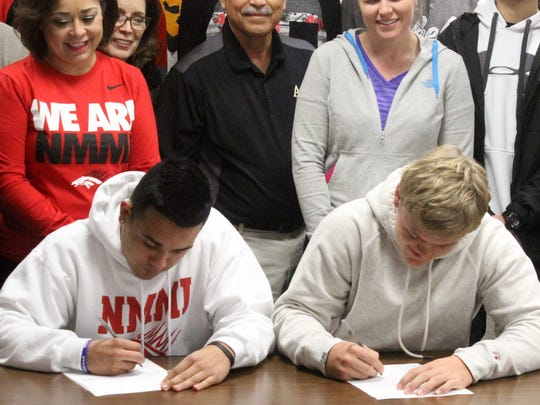 Julian Segura, left, signed with the New Mexico Military Institute while Hunter Graham, right, signed with New Mexico Highlands University.