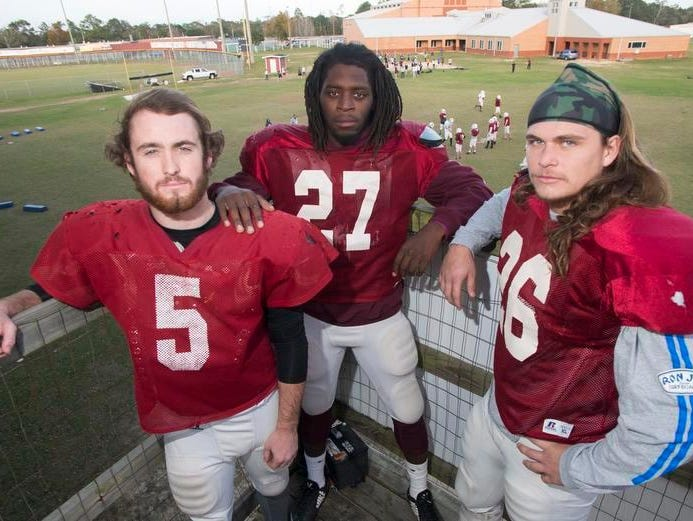 Tate High School seniors, Trace Penton, Alonte Thompson, center, and Dallas Ditto, right, are looking to finish their high school football careers on top. Tate will play Niceville in the Region 1-6a final in Niceville Friday night.