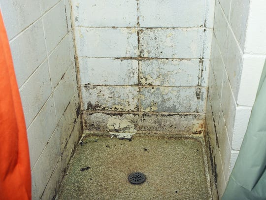 mold in a shower stall nside the Pickens County Detention