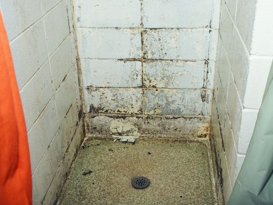 mold in a shower stall nside the Pickens County Detention Center