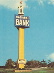 This First National Bank sign was on a tall pylon