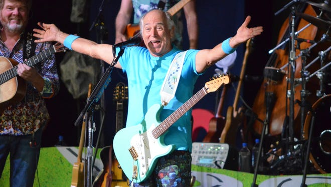 Jimmy Buffett greets the sold-out crowd at DTE Energy Music Theatre in Clarkston, Michigan, on June 18, 2016.
