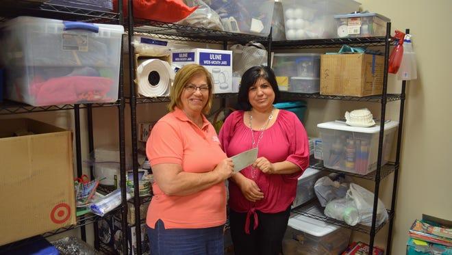 Christine Galvin, left, and Kristen Gerwin of the United Way of Ottawa County plan to use the Gannett Foundation grant for a kindergarten-preparedness program.
