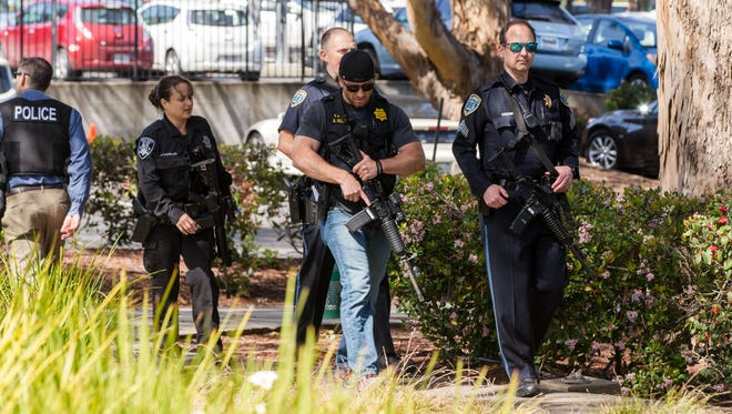 Law enforcement personnel outside of the YouTube headquarters.