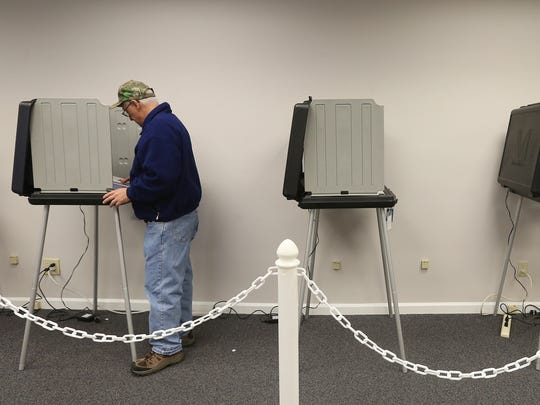Alan Leyo votes on the first day of early voting at