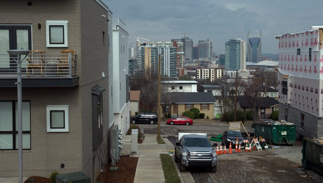 New houses go up along Archer Street in a neighborhood that was once built for affordable housing Jan. 18, 2017.
