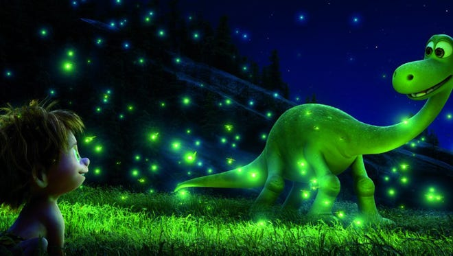 """A dinosaur named Arlo looks out for a lost boy in the Disney movie """"The Good Dinosaur."""""""