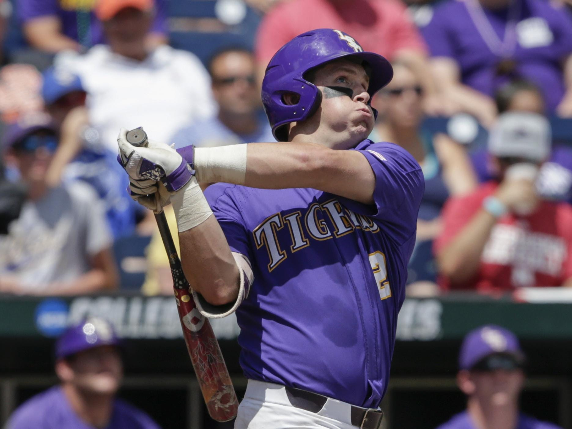 LSU's Michael Papierski (2) follows through on his three-run home run against Oregon State in the third inning of an NCAA College World Series baseball elimination game in Omaha, Neb., Saturday.