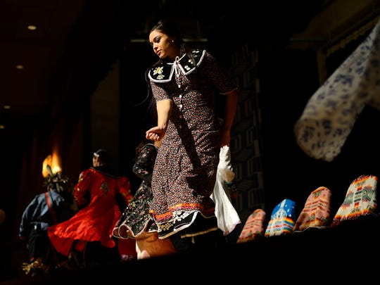 Oneida Smoke Dancers perform during the Oneida Nation's inauguration ceremony at the Radisson Hotel and Conference Center in Ashwaubenon on Thursday, Aug. 14, 2014.