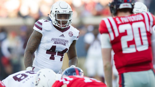 Mississippi State linebacker Leo Lewis is one of three individuals being sued by Rebel Rags.