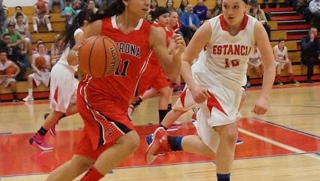 Corona's Payton Dunsworth drives to the basket in a game against Estancia's JV team Jan. 15.
