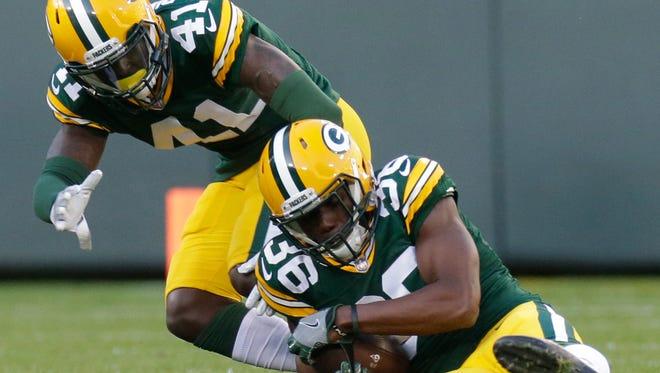 Green Bay Packers cornerback LaDarius Gunter (36) cradles an interception during the first quarter of their preseason game against the Los Angeles Rams Thursday, August 31, 2017 at Lambeau Field.