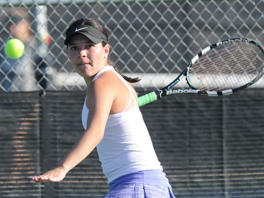 Wylie's Analeah Elias eyes the ball in her girls singles