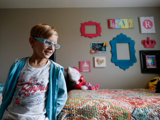 "Ryland Kelting, 9, with his walls decorated in traditionally girl-themed items, shows off his room Saturday, May 28, 2016. Kelley Kelting, Ryland's mother, said she had a ""total meltdown"" when they decided to redecorate his room from boy to girl, but ""now I am completely, 100 percent behind it."""