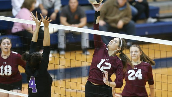 Ossining's Carmela Velardo (12) lays a shot over New