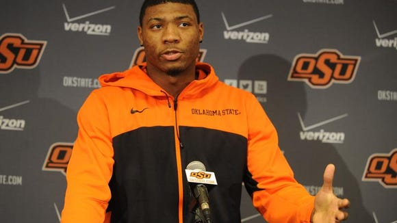 Oklahoma State guard Marcus Smart has been suspended for three games for shoving an abusive Texas Tech fan.