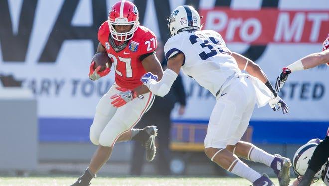 Georgia running back Nick Chubb looks to avoid the tackle of TCU linebacker Sammy Douglas during the Liberty Bowl.