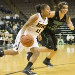 Iowa's Tania Davis dribbles around North Dakota's Kanani Asuncion during the first half of the Hawkeye's season opener at Carver Hawkeye Arena on Friday, Nov. 13.