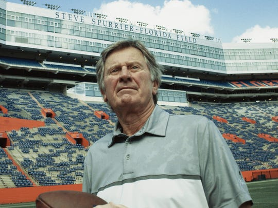 Steve Spurrier stands on the football field at University