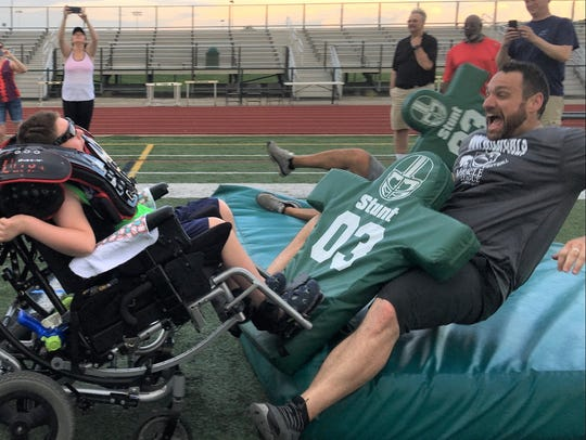 Russell Johnson, 10, of Livonia, wheels into Novi football