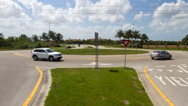 Cars navigate the roundabout at Williams Road and Via Coconut Point in Estero on Wednesday, April 6, 2016.