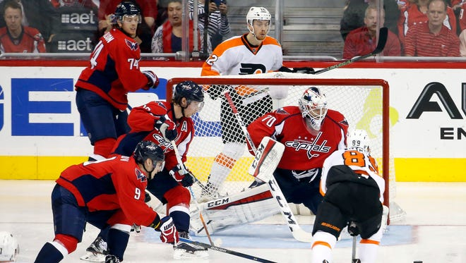 Capitals' goalie Braden Holtby makes a save on Flyers' center Sam Gagner (89) in the third period of Game 5 in Washington, a 2-0 Philadelphia win.