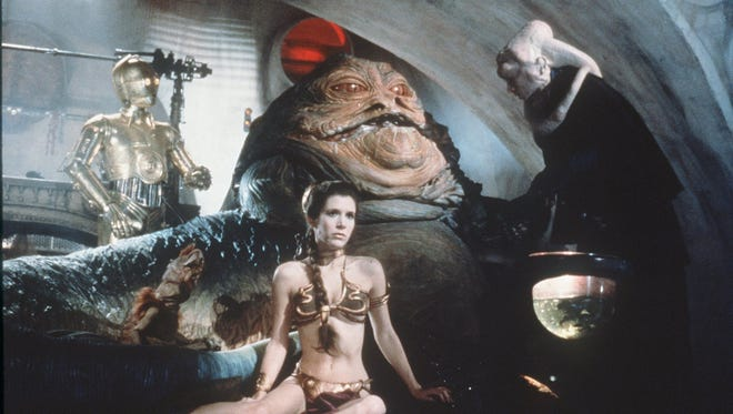 """Princess Leia (Carrie Fisher) plays captive to Jabba the Hut in """"Return of the Jedi Special Edition."""""""