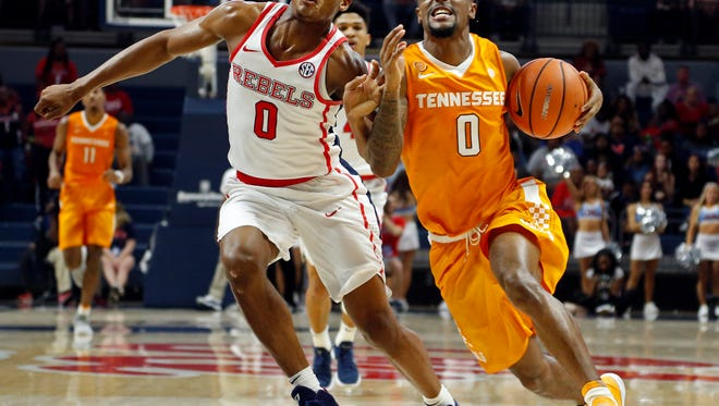 Ole Miss guard Devontae Shuler (0) attempts to steal the ball from Tennessee guard Jordan Bone (0) during the first half of Saturday's game.