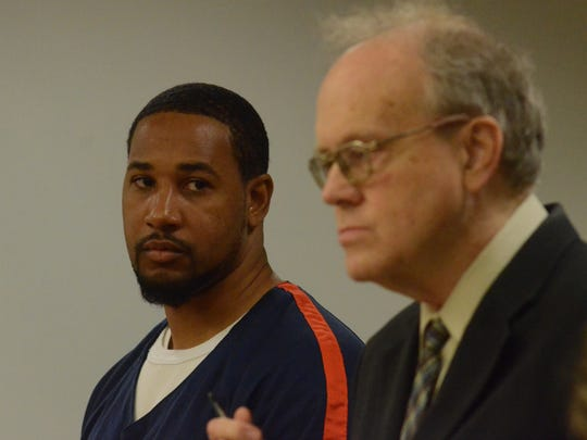Shawn McKnight stands with his attorney, Daniel Bremer, at Thursday's sentencing hearing.