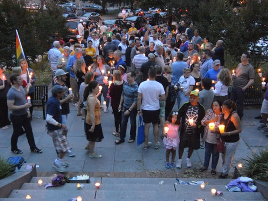 Supporters of the LGBTQ community gathered at the Soldiers and Sailors Monument in Wilmington on Monday evening to remember the victims of the mass shooting in Orlando on Sunday morning.