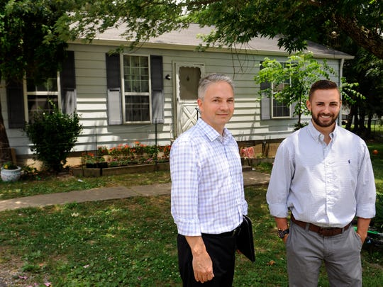 Real estate investor Tim King, left, and his son, Tyler King, stand by one of the two properties they purchased in 2014. King just sold 18 Nashville area homes to Streetlane Homes.