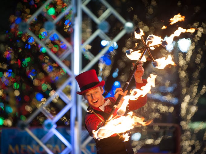Fire performer Eric Baker of Detroit Circus entertains