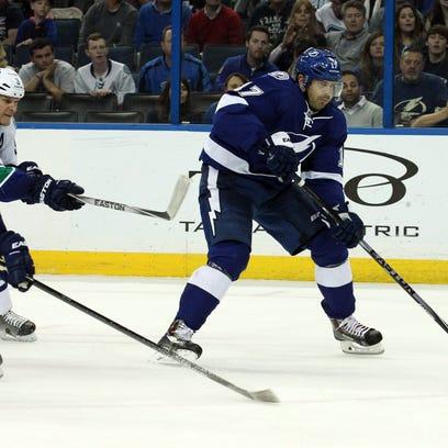 Lightning center Alex Killorn (17) skates with the