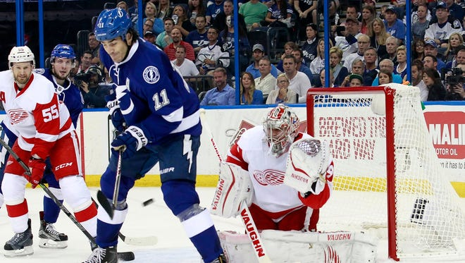 Detroit Red Wings goalie Petr Mrazek (34) makes a save as the puck goes though the legs of Tampa Bay Lightning center Brian Boyle (11) during the second period in game one of the first round of the the 2015 Stanley Cup Playoffs at Amalie Arena.