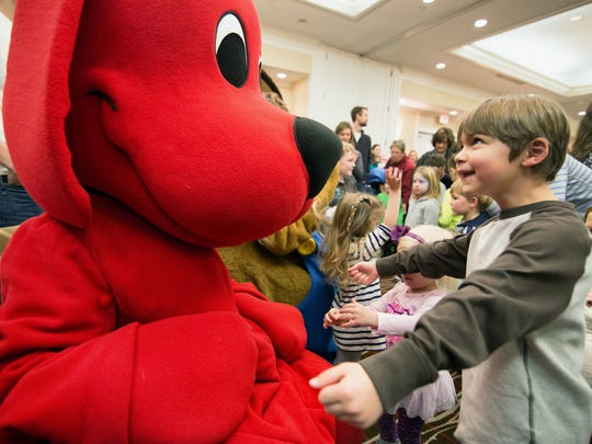 Caden Huntley reacts to meeting Clifford the Big Red Dog during One Book Two Book, a celebration of children's literature in the Iowa City UNESCO City of Literature.