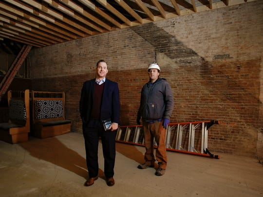 Jason Vanderstelt, left, and his brother Darrell , co-owners of Dutch Brothers Development Group in Charlotte, inside the future home of The Dolson.   Dutch Brothers has teamed up with The Potent Potables Project to create a scratch-kitchen concept.  The property is formerly The Gavel, which was in business for 32 years.
