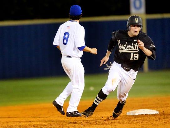 Vanderbilt's Stephen Scott (19) rounds second base