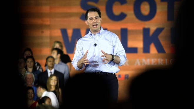 Wisconsin Gov. Scott Walker signed the bill on Monday, one week after he officially launched his Republican campaign for president.