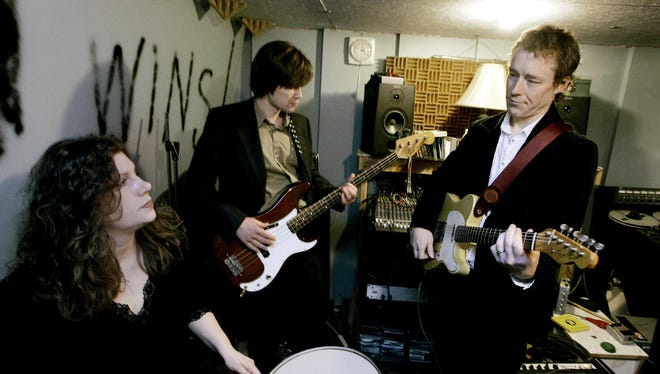 Mimi Parker, left, and her husband, Alan Sparhawk, right, jam with bassist Matt Livingston, in 2007 in Duluth.