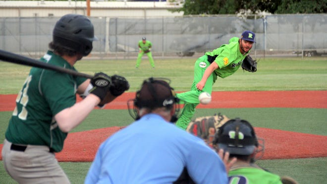Roswell Invaders pitcher Kale Fultz makes his delivery to the plate during Wednesday's professional baseball game against the Tucson Saguaros. The Invaders rallied late for an 8-5 victory at E.J. Hooten Park.