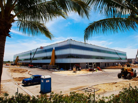 Construction continues Monday on the headquarters for Hertz in Estero.