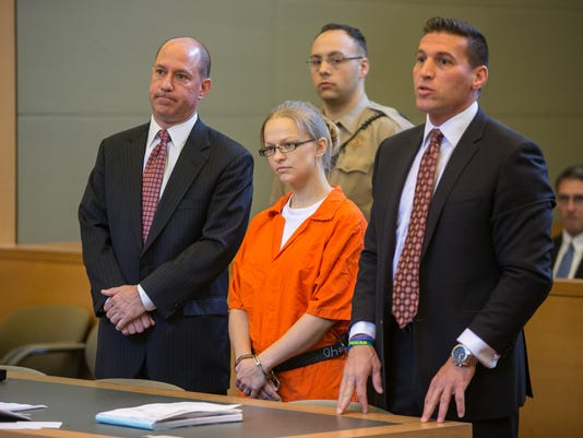 Angelika Graswald stands in court with her attorneys Jeffrey Chartier and Richard Portale at her arraignment in Goshen, NY on May 29, 2015. Ms. Graswald has been charged with second-degree murder and second degree manslaughter in death of her fiance, Vin