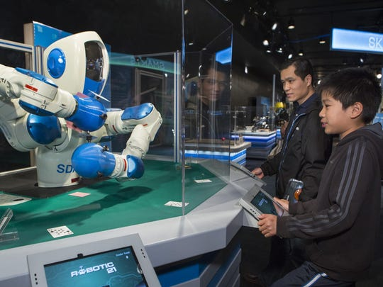 The Robotic21 System from Yaskawa Motoman Robotics of Japan allows guests to play a game of 21.