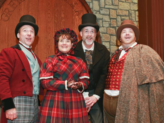 "Wayne Pyle, left to right, Maria Silverman, Darrell James and Ryan Walter are shown in Half Moon Theatre's production of ""A Christmas Carol."""