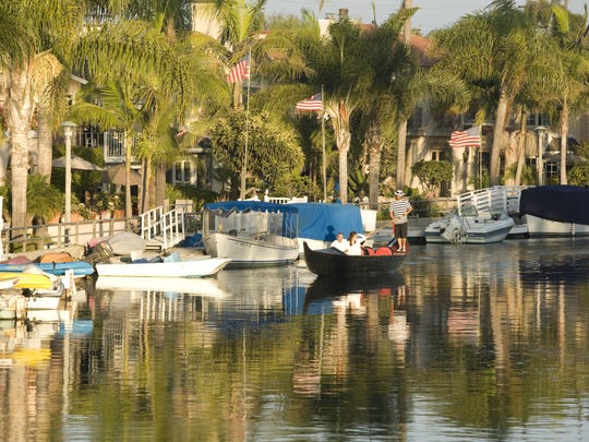 The Gondola Getaway takes cruise-goers down the scenic canal waterways of Naples, a Long Beach neighborhood.